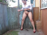 Milf In High Heels Smokes And Pisses While Standing Raising Her Skirt
